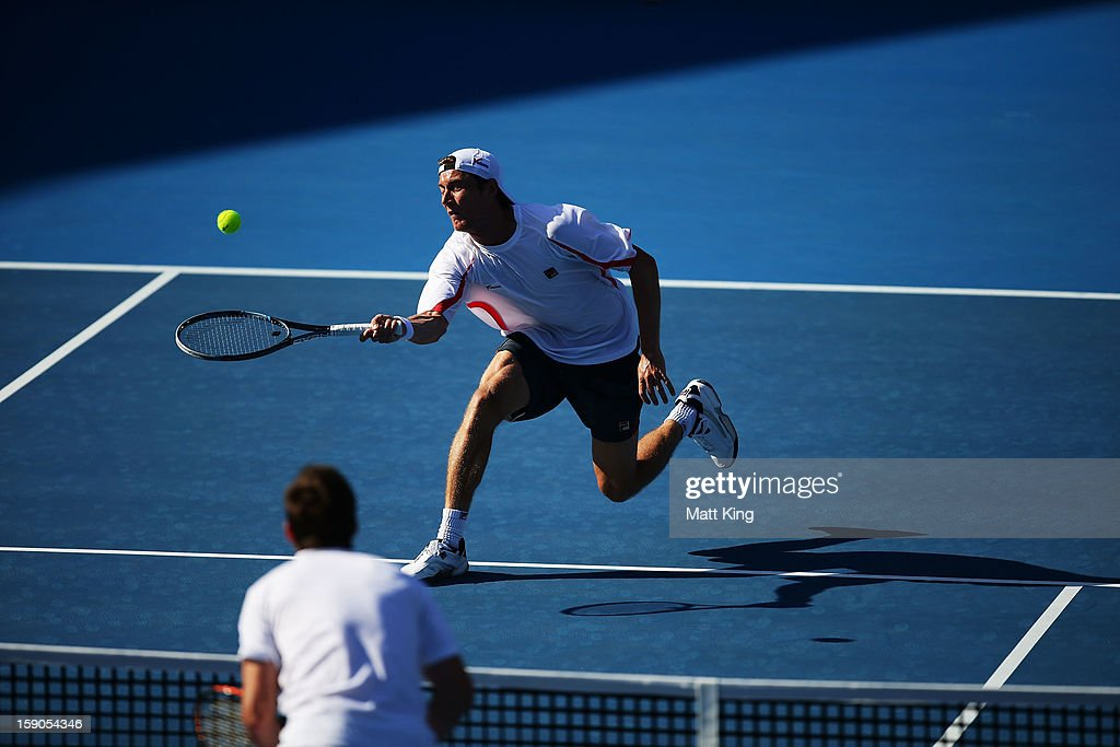 <a gi-track='captionPersonalityLinkClicked' href=/galleries/search?phrase=Matthew+Ebden&family=editorial&specificpeople=5662100 ng-click='$event.stopPropagation()'>Matthew Ebden</a> of Australia stretches out for a forehand volley in his first round match against Marcel Granollers of Spain during day two of the Sydney International at Sydney Olympic Park Tennis Centre on January 7, 2013 in Sydney, Australia.