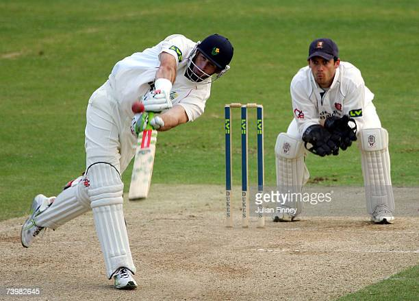 Matthew Elliott of Glamorgan hits a six as James Forster of Essex watches during the Liverpool Victoria County Championship Division 2 match between...