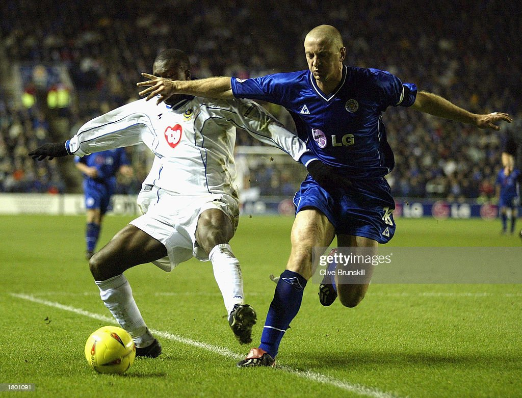 Matthew Elliott of Leicester holds off Yacubu Ayegbini of Portsmouth during the Nationwide League Division One match between Leicester City and Portsmouth at Walkers Stadium, Leicester, England on February 17, 2003.