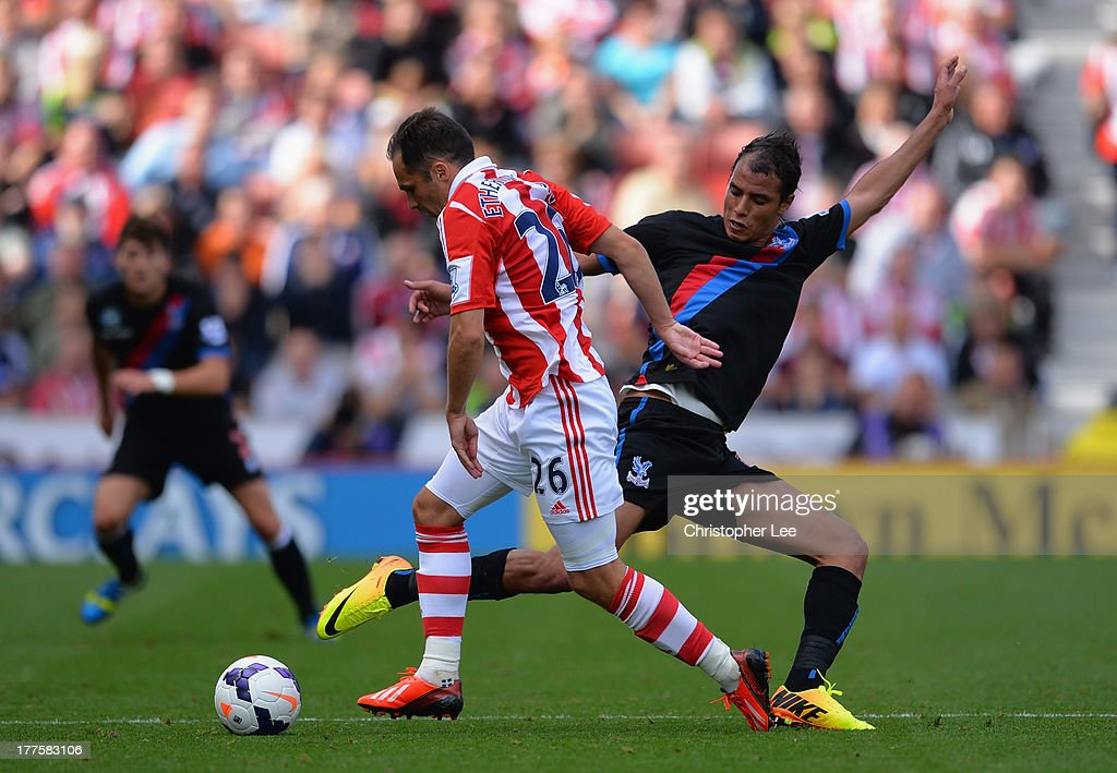 Matthew Etherington of Stoke City battles with MarMarouane Chamakh of Palace during the Barclays Premier League match between Stoke City and Crystal Palace at Britannia Stadium on August 24, 2013 in Stoke on Trent, England.