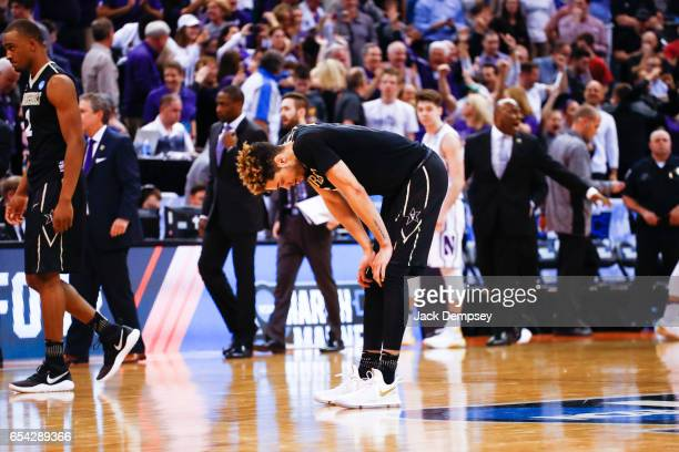 Matthew FisherDavis of Vanderbilt bows down after a loss against Northwestern University during the first round of the 2017 NCAA Men's Basketball...