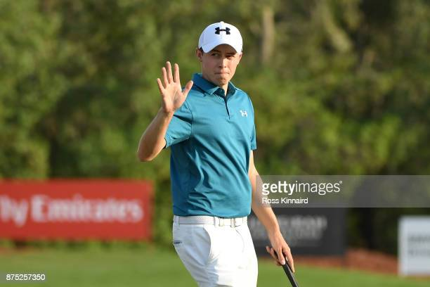 Matthew Fitzpatrick of England acknowledges the crowd on the 18th green during the second round of the DP World Tour Championship at Jumeirah Golf...