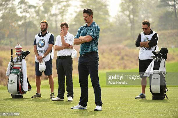 Matthew Fitzpatrick of England and Justin Rose of England stand for a minute silence as a mark of respect for those killed in the Paris bombings...