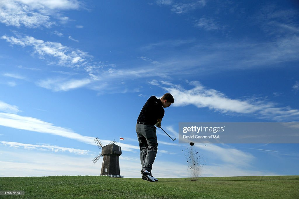 <a gi-track='captionPersonalityLinkClicked' href=/galleries/search?phrase=Matthew+Fitzpatrick+-+Golfer&family=editorial&specificpeople=8019521 ng-click='$event.stopPropagation()'>Matthew Fitzpatrick</a> of England and the Great Britain and Ireland team plays his second shot at the par 4, 16th hole during the first day afternoon singles matches of the 2013 Walker Cup Match at The National Golf Links of America on September 7, 2013 in Southampton, New York.