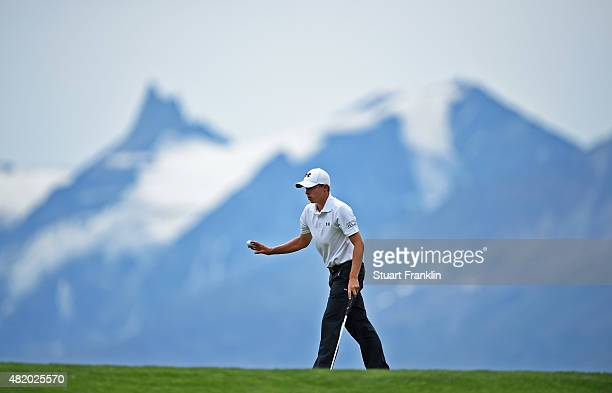 Matthew Fitzpatrick of England celebrates a putt during the final round of the Omega European Masters at CranssurSierre Golf Club on July 26 2015 in...