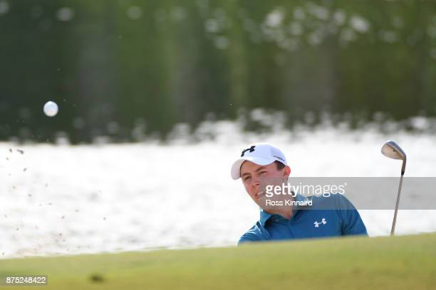 Matthew Fitzpatrick of England hits his second shot on the 17th hole during the second round of the DP World Tour Championship at Jumeirah Golf...