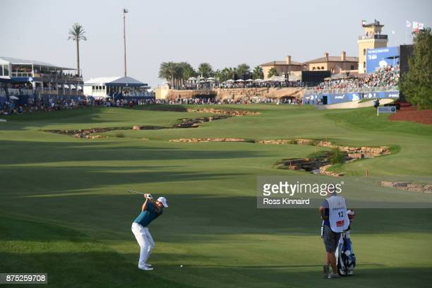 Matthew Fitzpatrick of England hits his second shot on the 18th hole during the second round of the DP World Tour Championship at Jumeirah Golf...