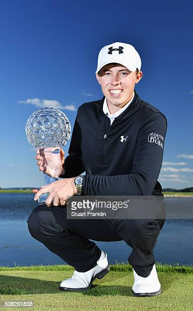 Matthew Fitzpatrick of England holds the trophy for winning the Nordea Masters at Bro Hof Slott Golf Club on June 5 2016 in Stockholm Sweden