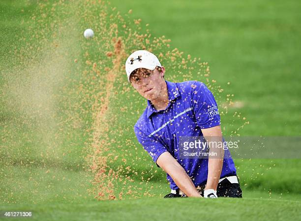 Matthew Fitzpatrick of England plays a bunker shot on the 18th hole during the third round of the South African Open at Glendower Golf Club on...