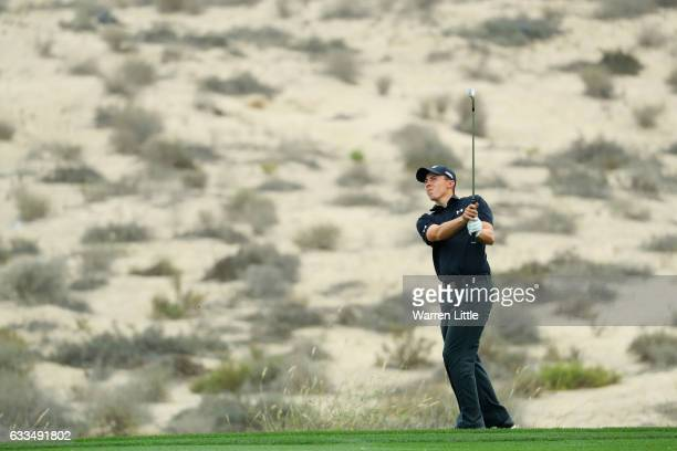 Matthew Fitzpatrick of England plays his second shot on the 8th hole during the first round of the Omega Dubai Desert Classic at Emirates Golf Club...