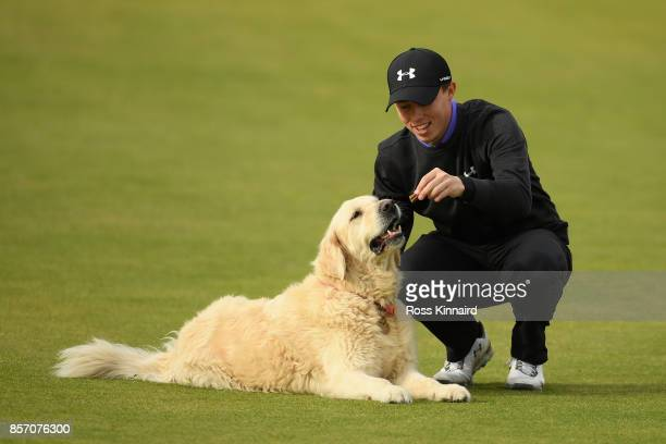 Matthew Fitzpatrick of England plays with his family dog Charlie during practice prior to the 2017 Alfred Dunhill Links Championship at Kingsbarns on...