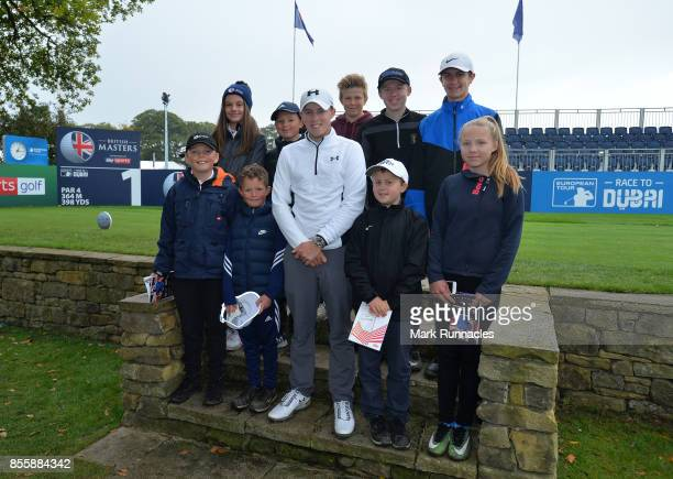 Matthew Fitzpatrick of England poses with children from the Junior Golf Sixes Academy at Ponteland Golf Club who won the Junior Golf Sixes Tournament...
