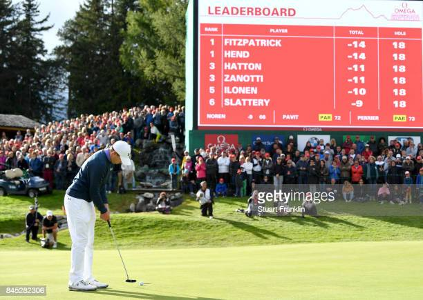 Matthew Fitzpatrick of England putts on on the 18th hole to win the play off during Day Five of the Omega European Masters at CranssurSierre Golf...