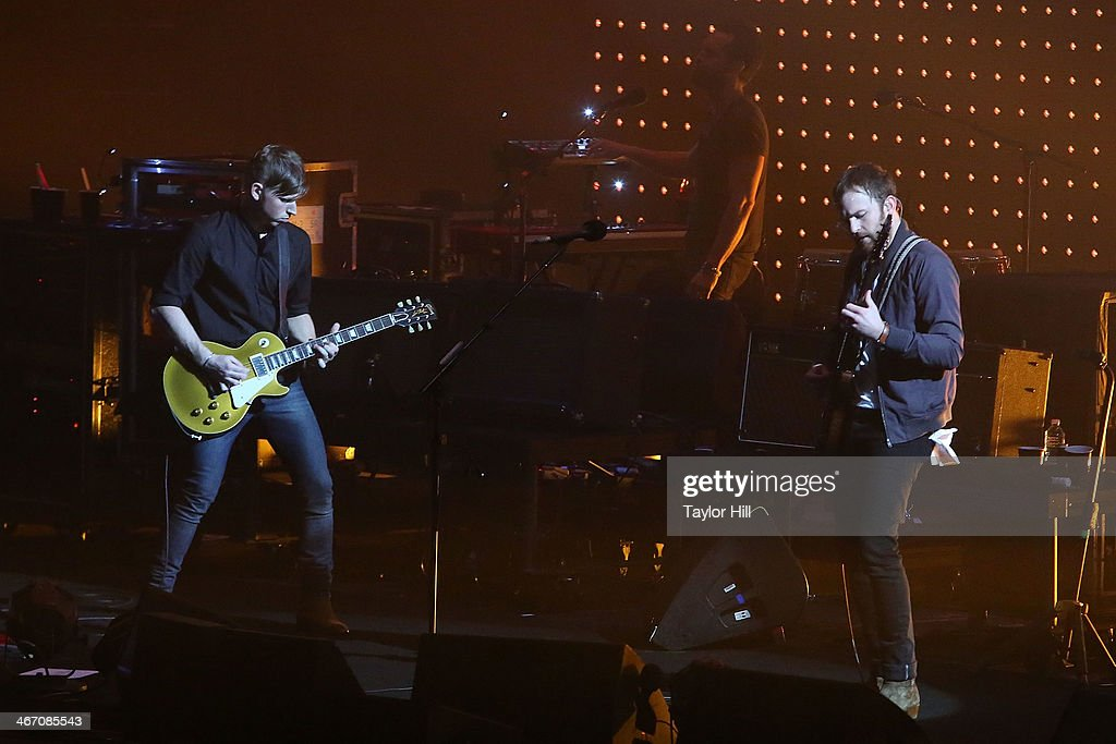 Matthew Followill and Caleb Followill of Kings of Leon perform in concert during the 'Mechanical Bull' tour at Philips Arena on February 5, 2014 in Atlanta, Georgia.