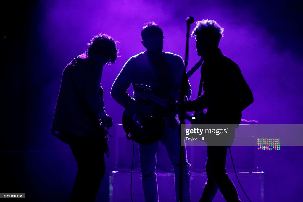 Matthew Followill, Caleb Followill, and Jared Followill perform at PNC Bank Arts Center on May 20, 2017 in Holmdel, New Jersey.