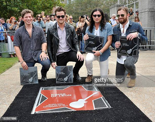 Matthew Followill Jared Followill Nathan Followill and Caleb Followill pose with plaques at their star on the Music City Walk Of Fame Induction...