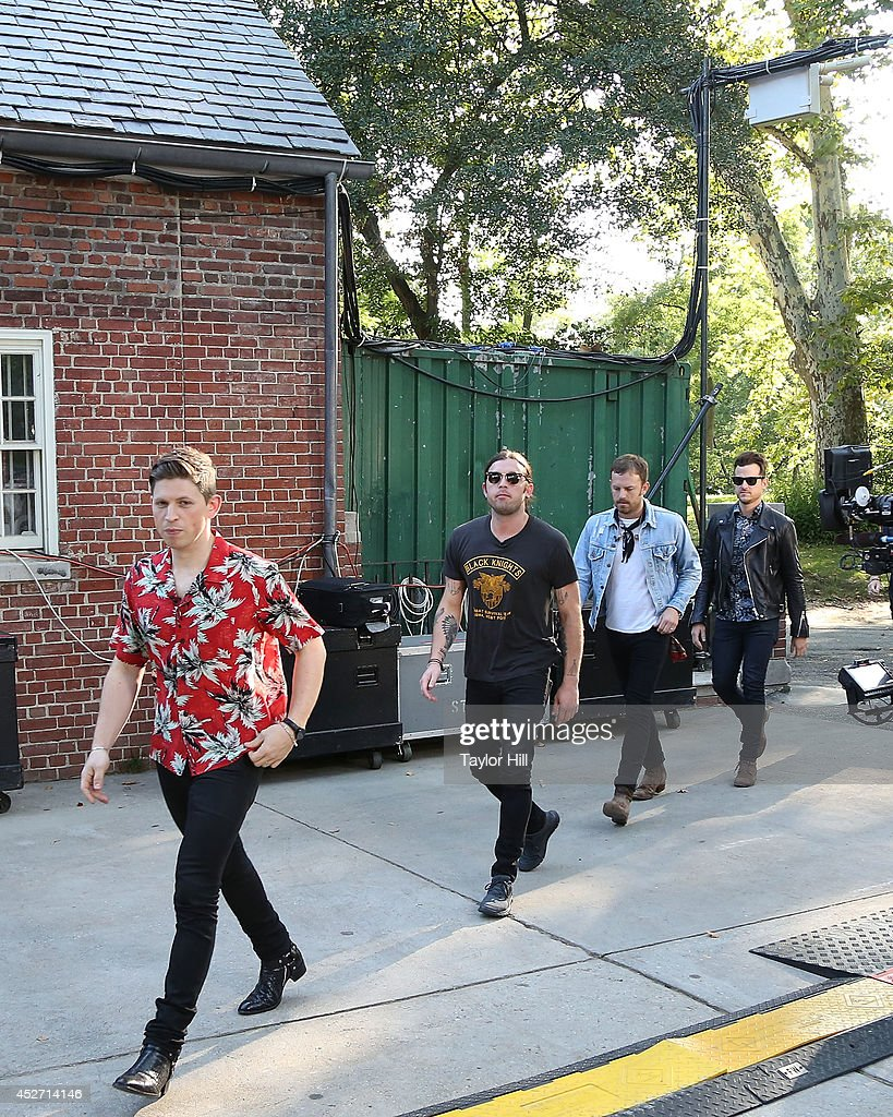 Matthew Followill, Nathan Followill, Caleb Followill, and Jared Followill of Kings of Leon arrive in Central Park on ABC's 'Good Morning America' at Rumsey Playfield, Central Park on July 25, 2014 in New York City.