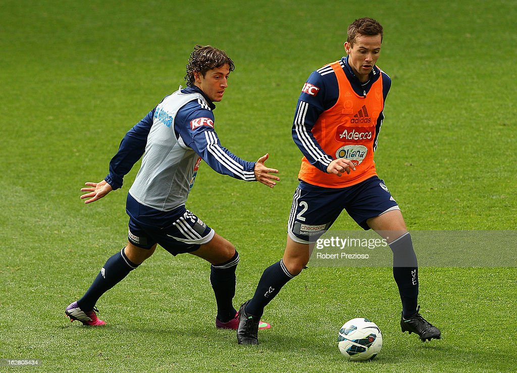 Matthew Foschini (R) controls the ball during a Melbourne Victory A-League training session at AAMI Park on February 28, 2013 in Melbourne, Australia.