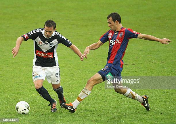 Matthew Foschini of the Victory controls the ball against Ben Kantarovski of the Jets during the round 22 ALeague match between the Melbourne Victory...