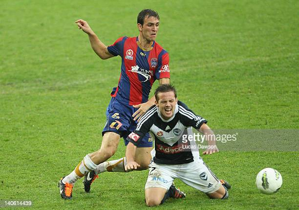 Matthew Foschini of the Victoryand Ben Kantarovski of the Jets contest for the ball during the round 22 ALeague match between the Melbourne Victory...