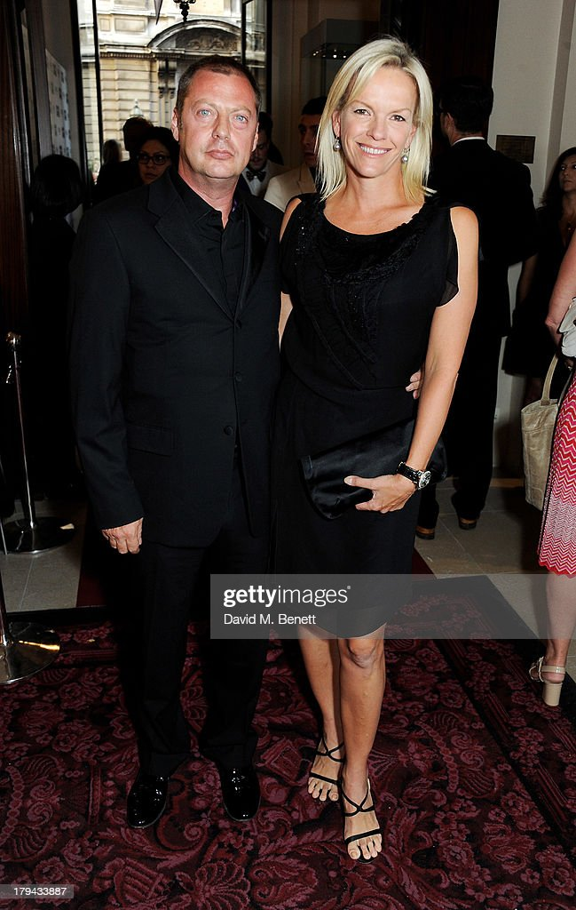 Matthew Freud (L) and Elisabeth Murdoch arrive at the GQ Men of the Year awards at The Royal Opera House on September 3, 2013 in London, England.