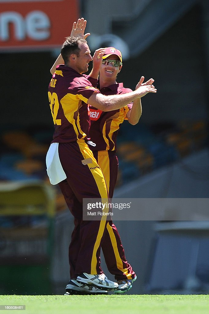 Matthew Gale and Nathan Hauritz of the Bulls celebrate a wicket during the Ryobi One Day Cup match between the Queensland Bulls and the Western Australia Warriors at The Gabba on February 2, 2013 in Brisbane, Australia.