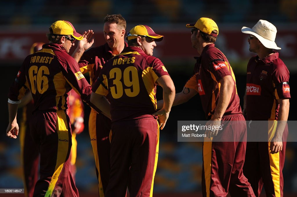 Matthew Gale (2nd L) of the Bulls celebrates a wicket with team mates during the Ryobi One Day Cup match between the Queensland Bulls and the Western Australia Warriors at The Gabba on February 2, 2013 in Brisbane, Australia.