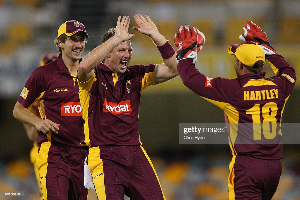 Matthew Gale of the Bulls celebrates with team mates after dismissing Brad Haddin of the Blues during the Ryobi One Day Cup match between the Queensland Bulls and the New South Wales Blues at The Gabba on November 21, 2012 in Brisbane, Australia.