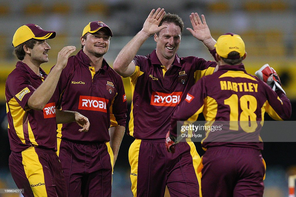 Matthew Gale of the Bulls celebrates with team mates after dismissing Ben Rohrer of the Blues during the Ryobi One Day Cup match between the Queensland Bulls and the New South Wales Blues at The Gabba on November 21, 2012 in Brisbane, Australia.