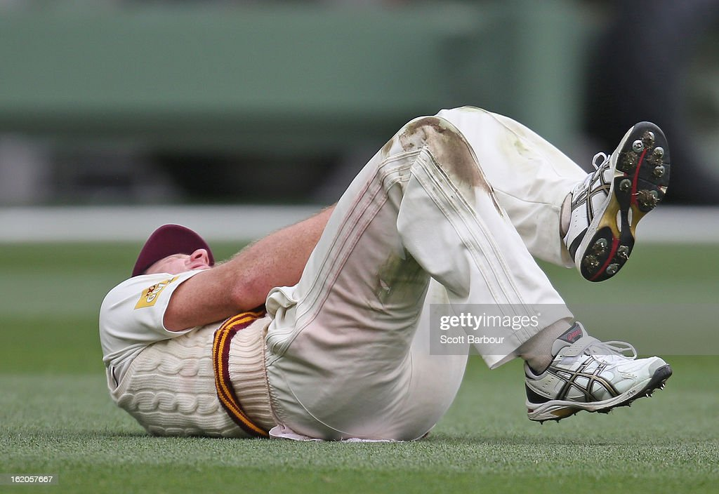 Matthew Gale of the Bulls clutches his leg after injuring his knee while fielding during day two of the Sheffield Shield match between the Victorian Bushrangers and Queensland Bulls at Melbourne Cricket Ground on February 19, 2013 in Melbourne, Australia.