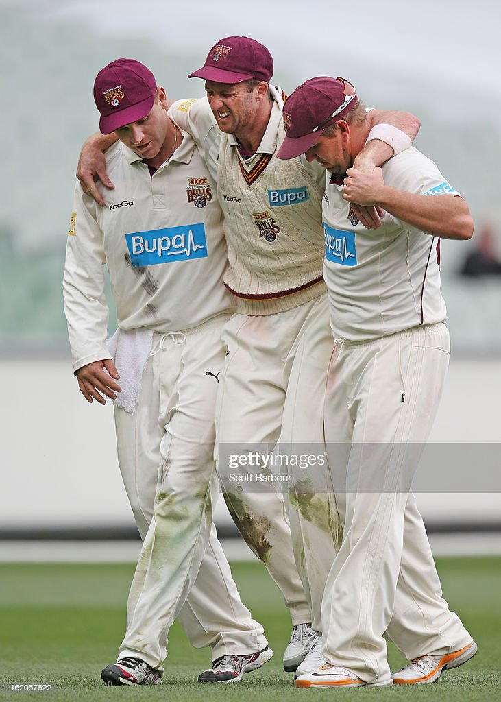 Matthew Gale of the Bulls is carried from the field by teammates <a gi-track='captionPersonalityLinkClicked' href=/galleries/search?phrase=James+Hopes&family=editorial&specificpeople=208940 ng-click='$event.stopPropagation()'>James Hopes</a> and <a gi-track='captionPersonalityLinkClicked' href=/galleries/search?phrase=Luke+Pomersbach&family=editorial&specificpeople=4042492 ng-click='$event.stopPropagation()'>Luke Pomersbach</a> after injuring his knee while fielding during day two of the Sheffield Shield match between the Victorian Bushrangers and Queensland Bulls at Melbourne Cricket Ground on February 19, 2013 in Melbourne, Australia.