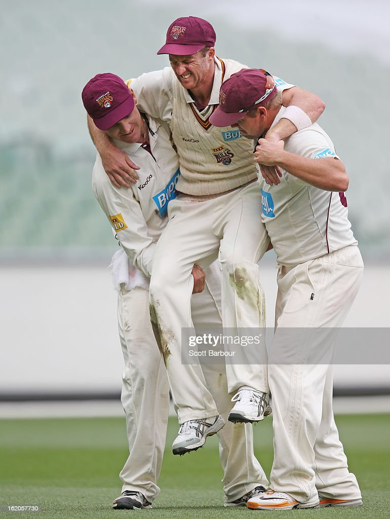 Matthew Gale of the Bulls is carried from the field by teammates James Hopes and Luke Pomersbach after injuring his knee while fielding during day two of the Sheffield Shield match between the Victorian Bushrangers and Queensland Bulls at Melbourne Cricket Ground on February 19, 2013 in Melbourne, Australia.