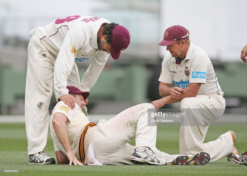 Matthew Gale of the Bulls is comforted by teammates <a gi-track='captionPersonalityLinkClicked' href=/galleries/search?phrase=James+Hopes&family=editorial&specificpeople=208940 ng-click='$event.stopPropagation()'>James Hopes</a> and Dominic Michael after injuring his knee while fielding during day two of the Sheffield Shield match between the Victorian Bushrangers and Queensland Bulls at Melbourne Cricket Ground on February 19, 2013 in Melbourne, Australia.