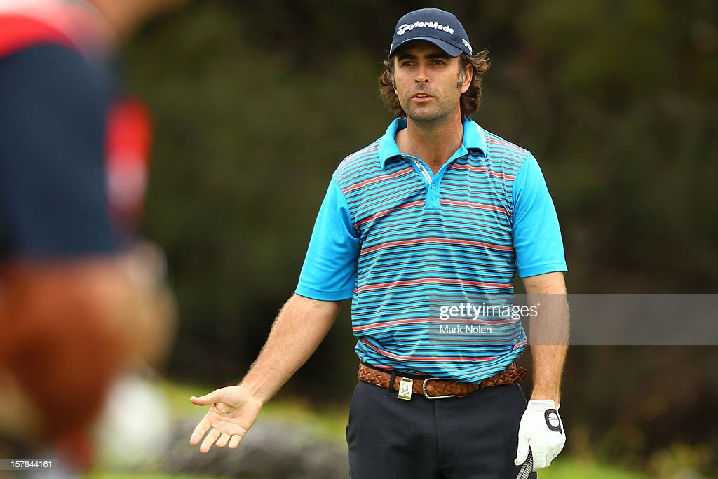 Matthew Goggin of Australia chats to his caddie during round two of the 2012 Australian Open at The Lakes Golf Club on December 7, 2012 in Sydney, Australia.