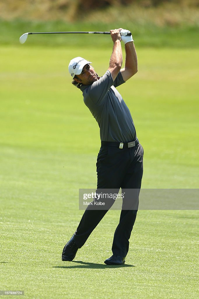 Matthew Goggin of Australia plays an approach shot during round three of the 2012 Australian Open at The Lakes Golf Club on December 8, 2012 in Sydney, Australia.