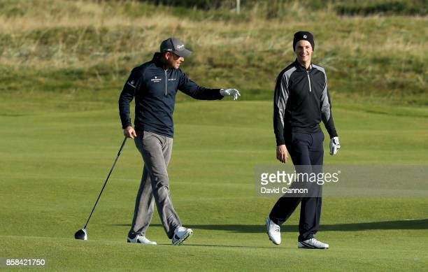 Matthew Goode of England the film and television actor with his professional playing partner David Howell of England during the second round of the...