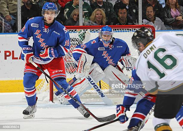 Matthew Greenfield and Doug Blaisdell of the Kitchener Rangers get set to face an incoming shot against the London Knights in an OHL game at the...
