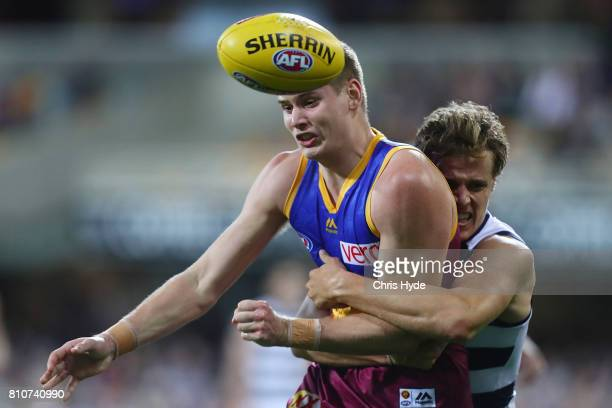 Matthew Hammelmann of the Lions is tackled by Jake Kolodjashnij of the Cats during the round 16 AFL match between the Brisbane Lions and the Geelong...