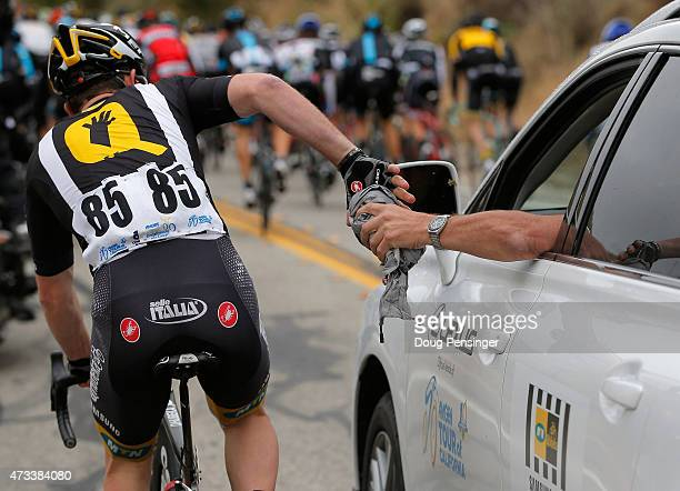 Matthew Harley Goss of Australia riding for MTNQhubeka collect rain gear from his team car during the climb of Balcom Canyon Road during stage five...