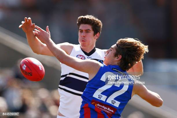 Matthew Harman of the Knights and Hugh Longbottom of the Chargers contest the ball during the TAC Cup Final between Oakleigh and Northern Knights at...