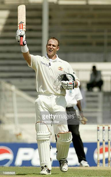Matthew Hayden of Australia celebrates his century during day two of the Second Test match between Pakistan and Australia played at Sharjah...