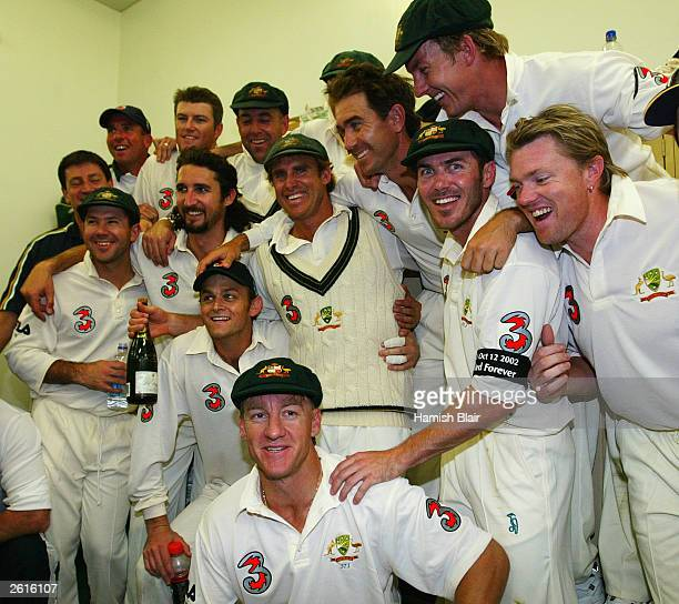 Matthew Hayden of Australia celebrates in the rooms with his team mates after scoring 380 to break Brian Lara of The West Indies world record of 375...