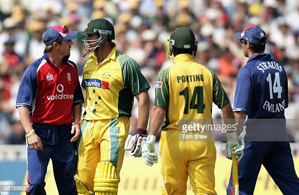 Matthew Hayden of Australia faces up with Paul Collingwood after Simon Jones of Engalnd's throw struck him on the chest as Ricky Ponting and Andrew...