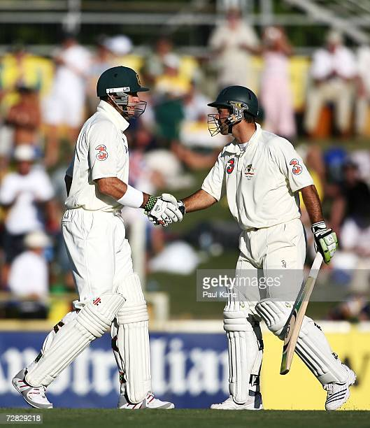 Matthew Hayden of Australia is congratulated by teammate Ricky Ponting after reaching his halfcentury during day two of the third Ashes Test Match...