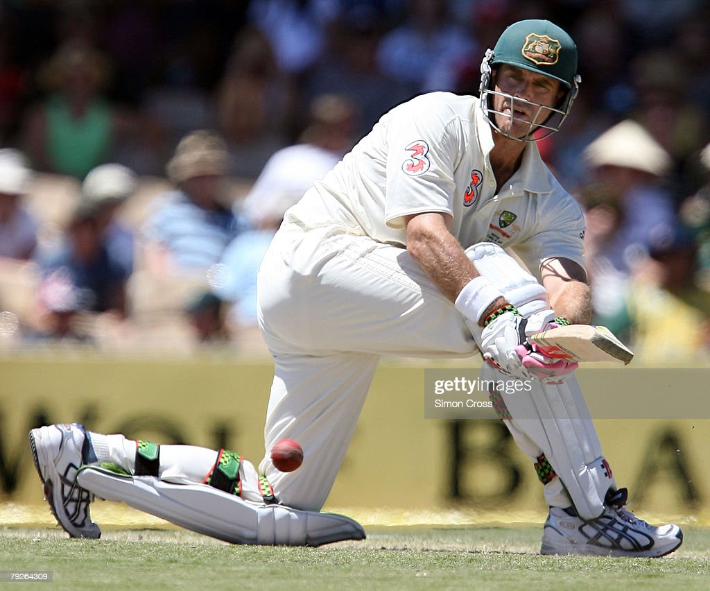 Matthew Hayden of Australia sweeps to bring up his century during day three of the Fourth Test between Australia and India at Adelaide Oval January...