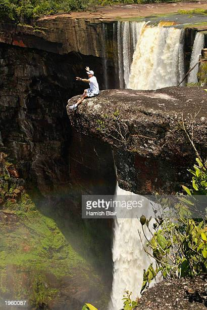 Matthew Hayden of Australia takes in the sights at Kaieteur Falls on a rock ledge over a 741 foot drop during a team trip to Kaieteur and Orinduik...