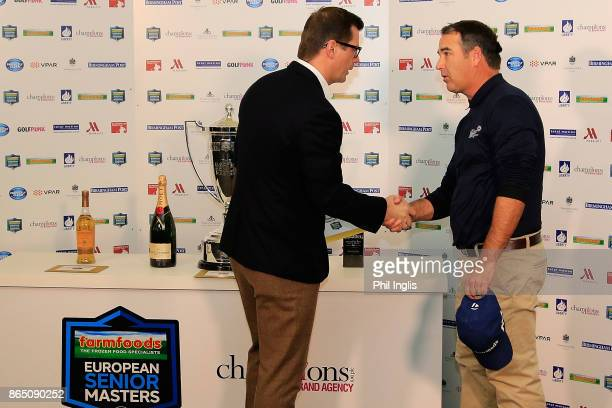 Matthew Hayes of Champions plc presents the joint runner up prize to Clark Dennis of United States after the final round of the Farmfoods European...