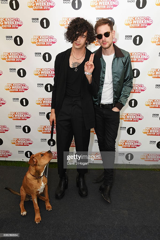 Matthew Healy and Adam Hann of The 1975 pose for a photo during day 2 of BBC Radio 1's Big Weekend at Powderham Castle on May 29, 2016 in Exeter, England.