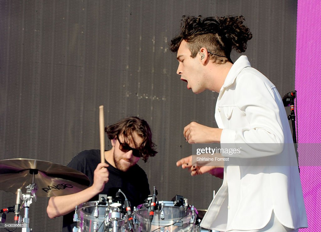 <a gi-track='captionPersonalityLinkClicked' href=/galleries/search?phrase=Matthew+Healy&family=editorial&specificpeople=10172163 ng-click='$event.stopPropagation()'>Matthew Healy</a> and <a gi-track='captionPersonalityLinkClicked' href=/galleries/search?phrase=George+Daniel+-+Musician+-+The+1975&family=editorial&specificpeople=12195934 ng-click='$event.stopPropagation()'>George Daniel</a> of The 1975 perform on The Other Stage at Glastonbury Festival 2016 at Worthy Farm, Pilton on June 25, 2016 in Glastonbury, England.