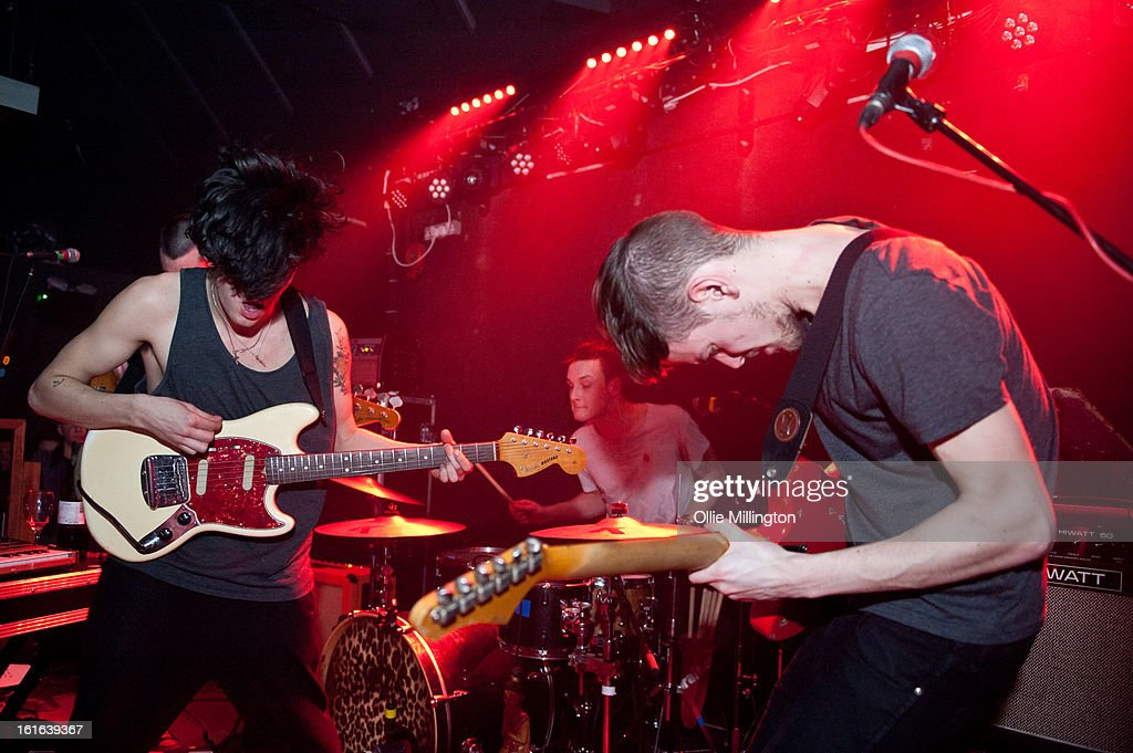 Matthew Healy, George Daniel and Adam Hann of The 1975 perform on stage at The Bodega Social Club on February 13, 2013 in Nottingham, England.